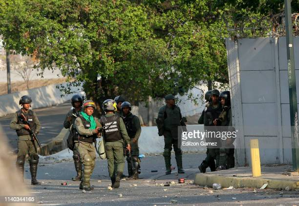 ProMaduro military forces clash with proGuaidó demonstrators near La Carlota air force on April 30 2019 in Caracas Venezuela Through a live broadcast...