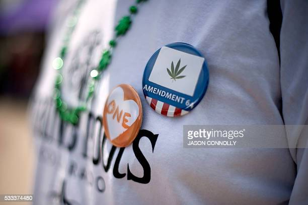 Promarijuana buttons are seen during the Denver 420 Rally the world's largest celebration of both the legalization of cannabis and cannabis culture...