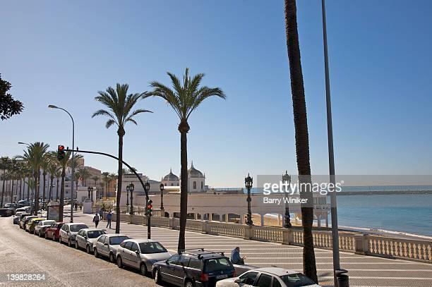 promenade along atlantic ocean, cadiz, andalucia, spain - wrong way stock pictures, royalty-free photos & images
