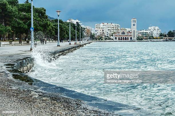 promenade by sea against sky - volos stock pictures, royalty-free photos & images