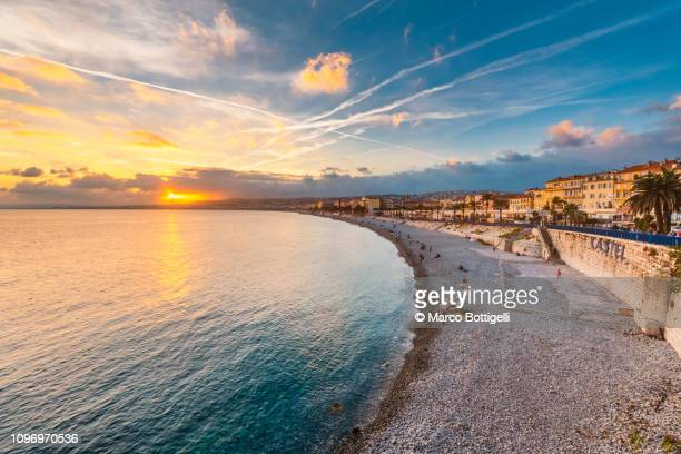 promenade des anglais at sunset, nice, french riviera - france stock pictures, royalty-free photos & images