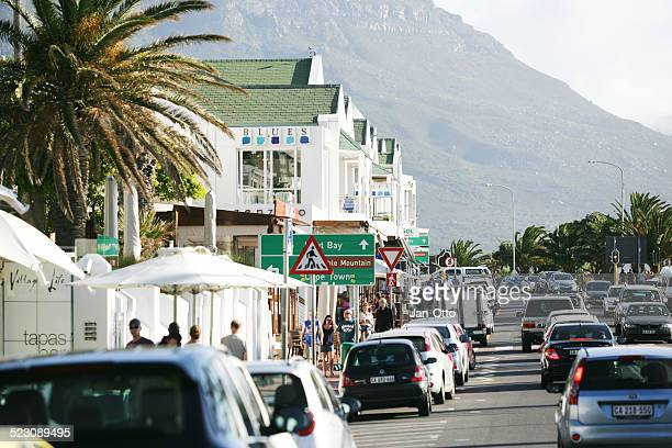 promenade in camps bay - quayside stock photos and pictures