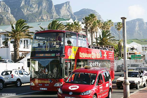 Promenade in Camps Bay with sightseeing bus