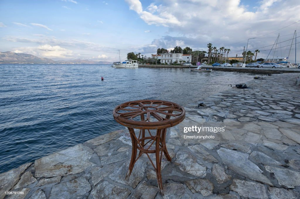Promenade with a wooden table in Datca on a cloudy winter day , Aegean Turkey.. : Stock Photo