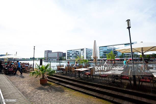 Promenade with tables of restaurants in Innenhafen Duisburg