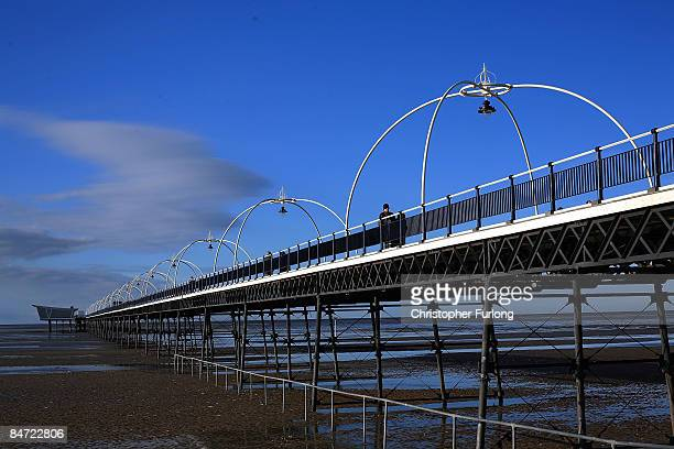 Promenaders enjoy the bright sunshine in the north west of England at Southport Pier on February 10, 2009 in Southport, England. The United Kingdom...