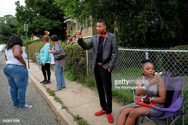 Promgoers Khalil Bridges 2nd from L and Courtney Holder R wait for their ride to the prom on Friday May 20 in Baltimore MD Bridges is an 18yearold...