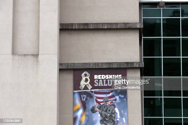 A promilitary banner hangs on the outside of FedEx Field home of the NFL's Washington Redskins team July 13 2020 in Landover Maryland The team...
