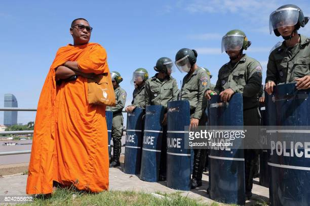 Prominent activist monk Venerable Loun Sovath confronts riot police during a march to the National Assembly to submit a petition seeking a new...