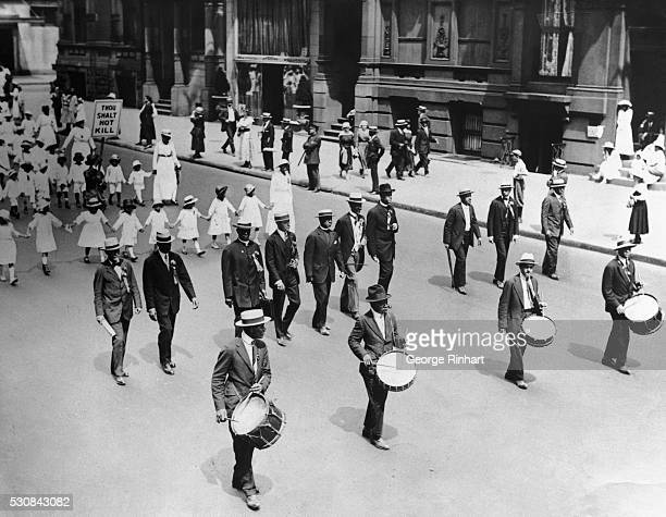 Prominent African Americans residents of the city paraded on Fifth Avenue in protest of the recent East St Louis riots Many signs they carried stated...