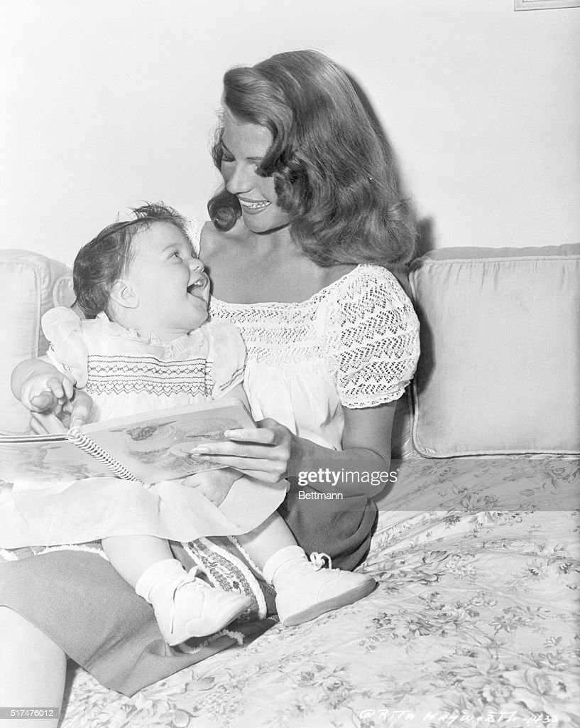 Prominent American film star Rita Hayworth is shown here spending time with her daughter, Rebecca Welles.