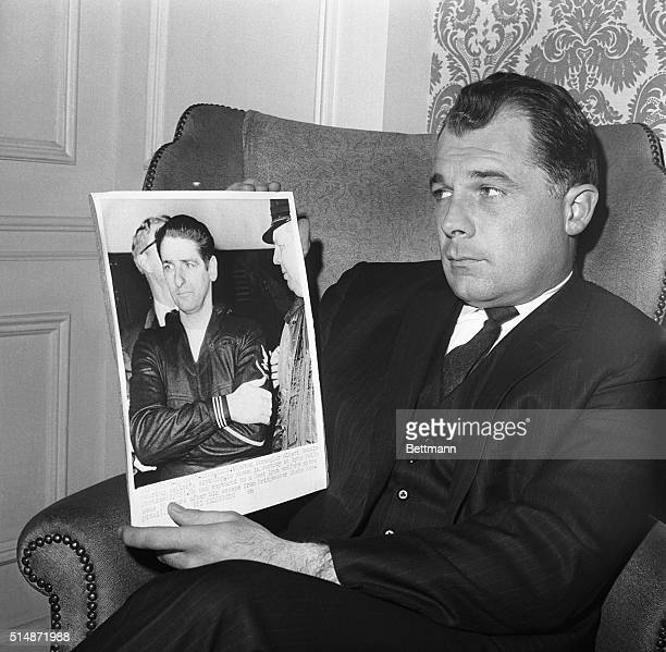 Prominent defense attorney F Lee Bailey holds a photo of his client Albert De Salvo the Boston Strangler during his capture after an escape