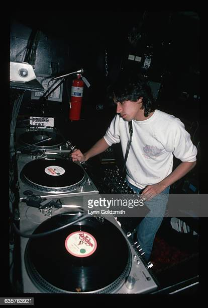 Prominent disco DJ Jellybean Benitez plays records in a discotheque DJ booth