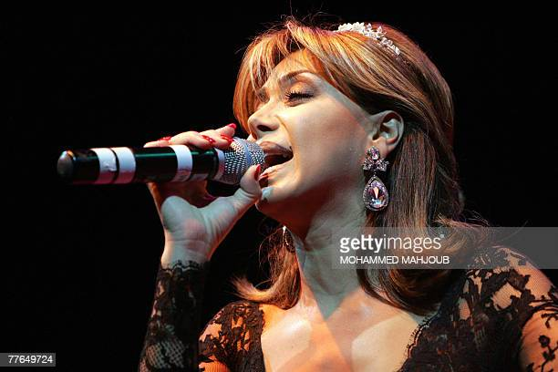 Prominent Lebanese singer Nawal alZoghbi performs during a concert in Muscat late 01 November 2007 AFP PHOTO/MOHAMMED MAHJOUB