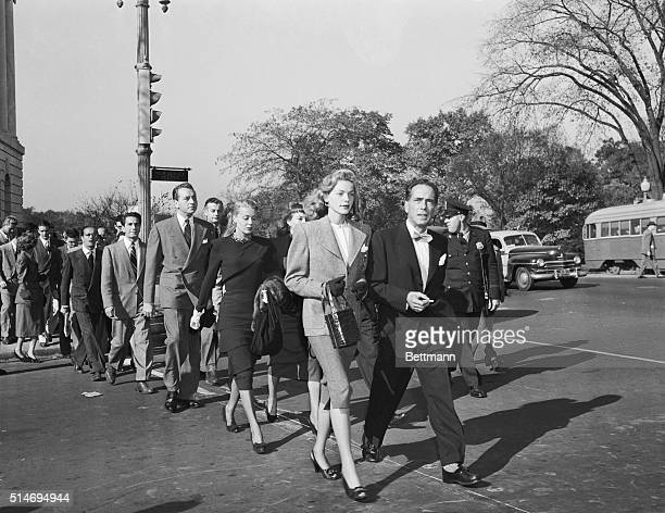 Prominent motion picture stars, lead by Lauren Bacall and Humphrey Bogart, cross a Washington, DC street to protest hearings by the House Committee...