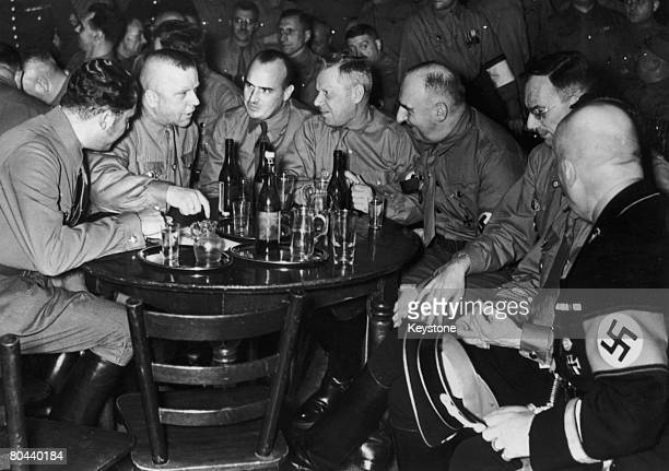 Prominent Nazi Party members at a party to mark the 15th anniversary of the 1923 Beer Hall Putsch, Munich, 9th November 1938. Among the group are...