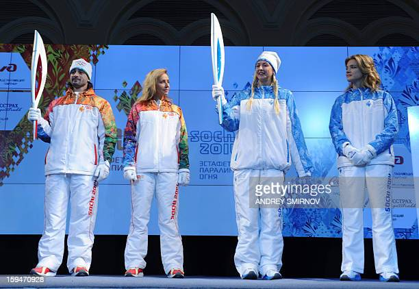 Prominent Russian athletes, ice dancer, Olympic silver medalist, Ilia Averbukh holds the newly unveiled Sochi 2014 Olympic Torch as paralympic...