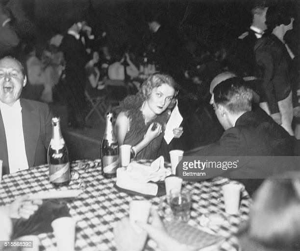 Prominent socialite Doris Duke with friends at the May Ball held in 1933 in New York for the benefit of Mrs Franklin D Roosevelt's Canteens for...