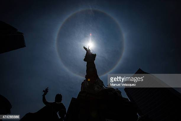 Prominent sun halo is seen around the sun at Angel de la Independencia on May 21 in Mexico City, Mexico. The halo is one type of optical phenomenon,...