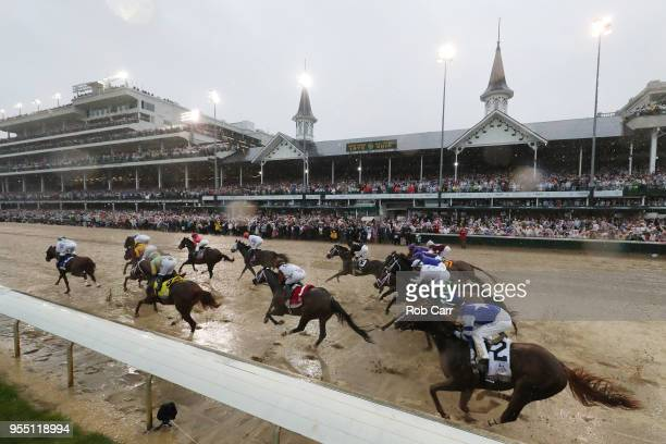 Promises Fulfilled ridden by jockey Corey Lanerie and Justify ridden by jockey Mike Smith lead the field to the first turn during the 144th running...