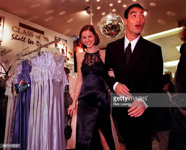 LSpromlead0328RL––Santa Ana––Melissa Gutierrez of Los Angeles models a dress by Morgan Company during a prom make–over seminar held at Macy's in...