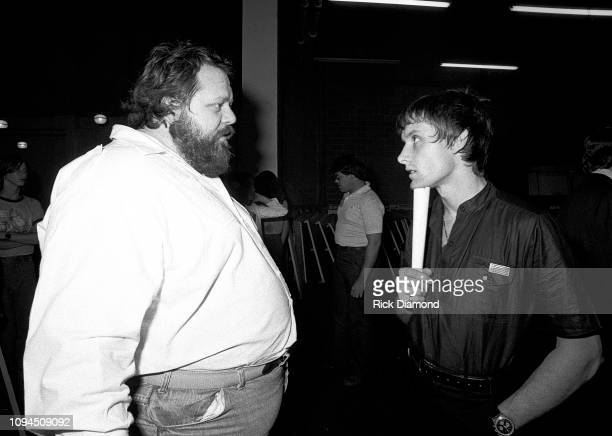 Promoter Alex Cooley chats with Carl Palmer of Emerson Lake and Palmer backstage June 23 1977 at The OMNI Coliseum