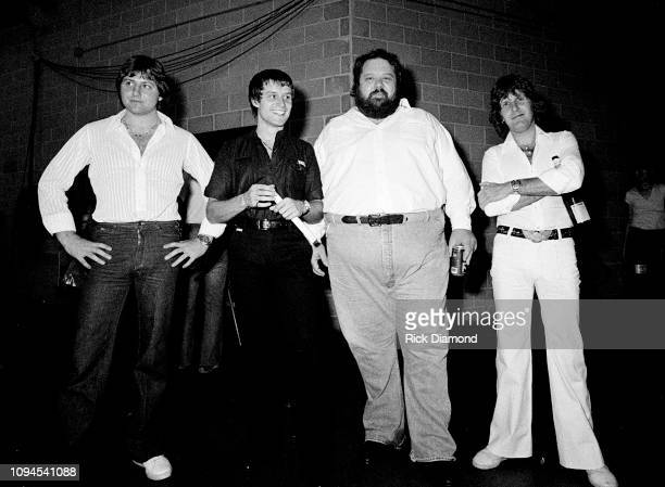 Promoter Alex Cooley with ELP's Greg Lake Carl Palmer and Keith Emerson of Emerson Lake and Palmer backstage at The OMNI Coliseum in Atlanta Georgia...