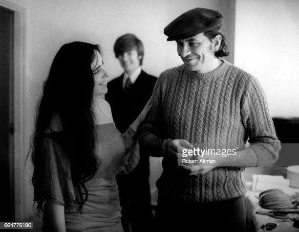 Promoter Bill Graham talks with singer Laura Nyro before a concert at the Berkeley Community Center on January 24 1970 in Berkeley California