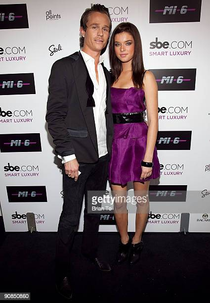 Promoter Dean May and model Brittany Brousseau attend Mi6 Nightclub Grand Opening Party on September 15 2009 in West Hollywood California