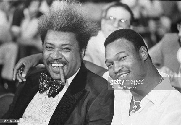 Promoter Don King poses with Larry Holmes on August 9,1980 in Las Vegas, Nevada.