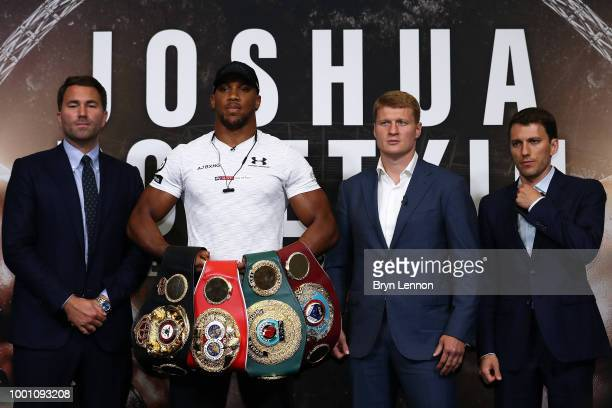 Promoter Eddie Hearn Anthony Joshua and Alexander Povetkin attend a press conference at Wembley Stadium on July 18 2018 in London England