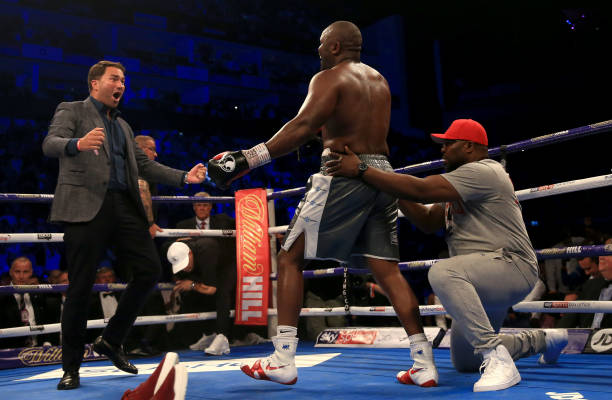 Promoter Eddie Hearn celebrates victory with Dereck Chisora in the ring after the Heavyweight fight between Dereck Chisora and Carlos Takam at The O2...