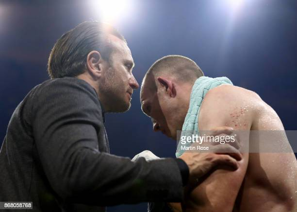 Promoter Kalle Sauerland talks to Juergen Braehmer of Germany after the fight against Rob Brant of the United States during the Ali Trophy Super...