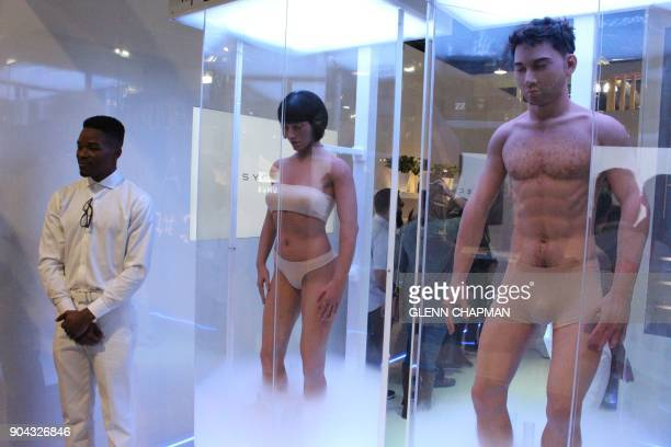 A promoter stands near human models as part of a stunt by Netflix to promote a new show 'Altered Carbon' at the Consumer Electronics Show in Las...