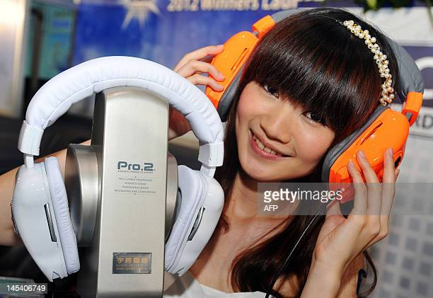 Promoter wears a Pro.2 headphone during a pre-show press conference for the 2012 Computex Taipei on May 29, 2012. Computex is Asia's biggest annual...