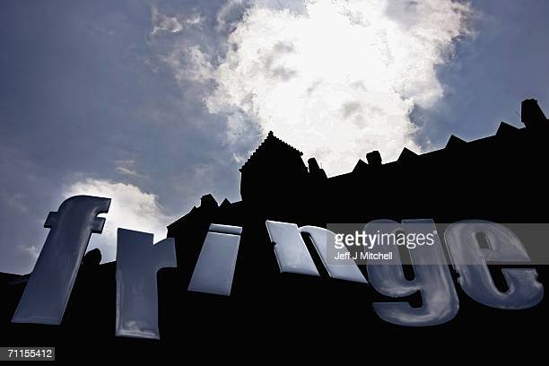 Promoters of the Edinburgh Fringe Festival hold up Fringe letters at Edinburgh Castle on June 8 2006 in Edinburgh Scotland The programme launch marks...