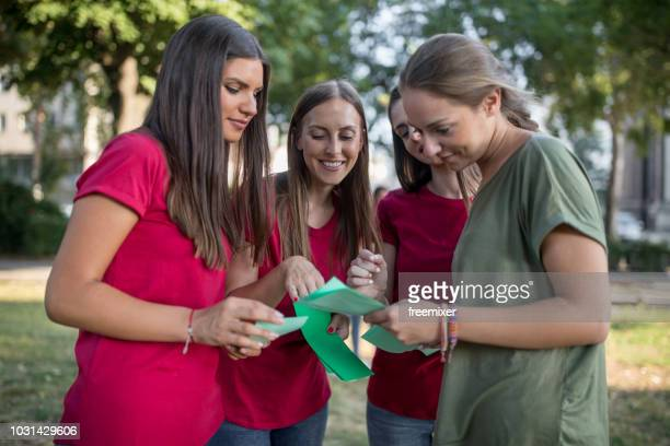 promoters sharing flyers in the park - flyer stock pictures, royalty-free photos & images