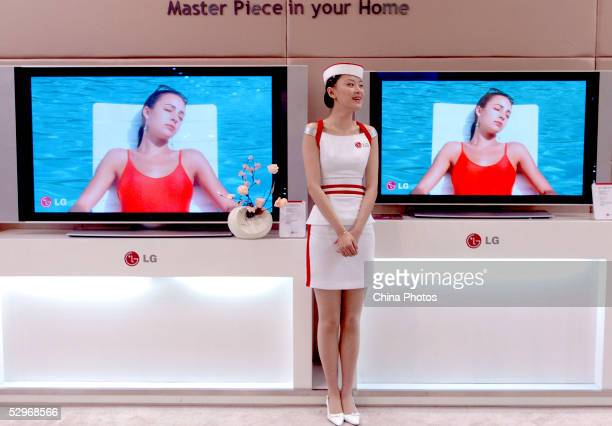 Promotion girl shows LG's Televisions at the China International High-tech exhibition on May 23, 2005 in Beijing, China. China, the world's...