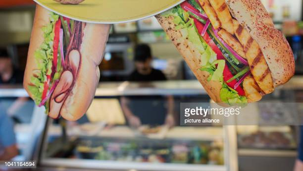 Promotion hangs inside the fast food chain Subway in Hannover, Germany, 21 August 2015. The sandwich fast food chain will celebrate its 50th birthday...