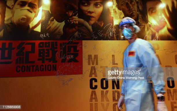 Promotion staff dresses in protective outfit to imitate hygiene officers during the SARS outbreak in Hong Kong in 2003, at the premiere of Hollywood...