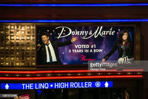 A promotional billboard featuring Donny Marie Osmond is viewed at Flamingo Hotel Casino on December 17 2018 in Las Vegas Nevada During the Christmas...
