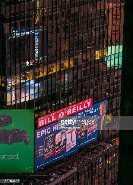 A promotional billboard for Bill O'Reilly's series of history books shine brightly above Times Square on October 23 2013 in New York City With a full...