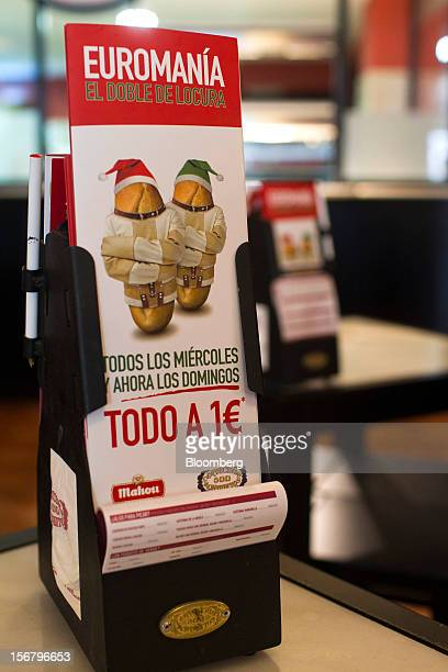 Promotional cards advertising one euro menus as part of 'Euromania' Wednesdays stand on tables in a 100 Montaditos restaurant in Madrid Spain on...