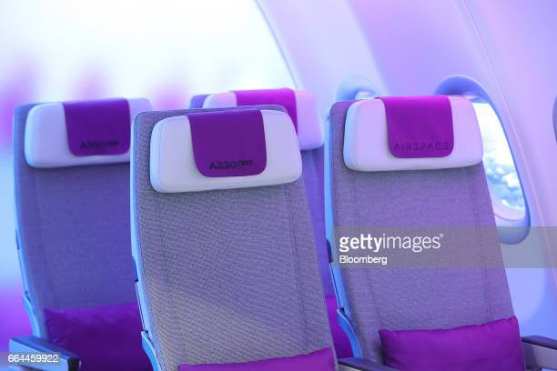 Promotional display demonstrates the 'cabin experience' and interior seating of an Airbus Group A330 neo aircraft in the Airbus Airspace pavilion at...