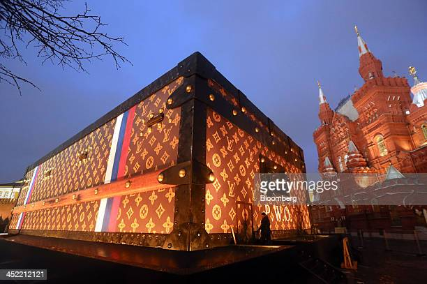 A promotional exhibit for Louis Vuitton a large wooden chest adorned in the trademark pattern and logo of luxury manufacturer LVMH Moet Hennessy...