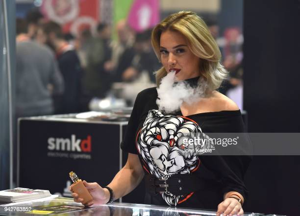 A promotional girl vapes during the Vape Jam UK 4 at ExCel on April 6 2018 in London England Vape Jam UK the premier Electronic Cigarette and ELiquid...
