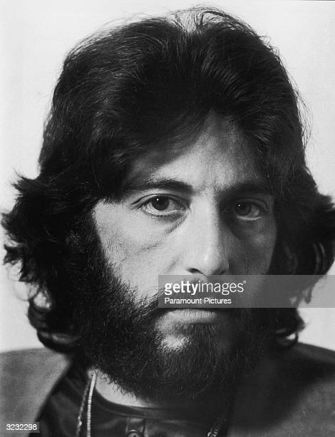 Promotional headshot portrait of American actor Al Pacino with shaggy hair and a beard for director Sidney Lumet's film 'Serpico' The film was based...