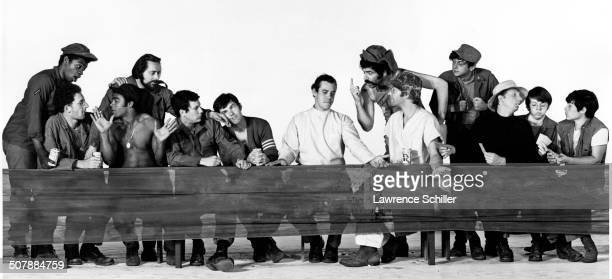 Promotional image from a photo shoot that features some of the cast from the film 'MASH' which echos a scen from the film wherein the tableau from Da...