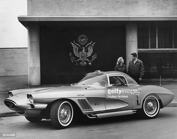 Promotional image of a couple laughing while posing behind an XP700 1958 Corvette by Chevrolet The automobile featured a conventional chassis with a...