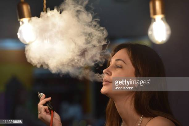 Promotional person Andrea vapes during Vape Jam 2019 at ExCel on April 12 2019 in London England Vape Jam UK the premier Electronic Cigarette and...
